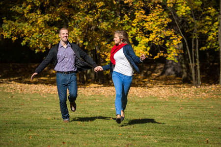 health care fight: Healthy lifestyle - woman and man running in park