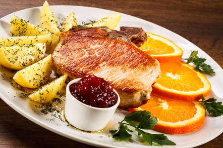 chops: Grilled steak, boiled potatoes and lingonberry jam