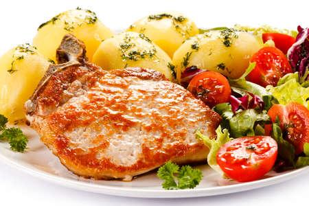pork chop: Fried steak, boiled potatoes and vegetable salad