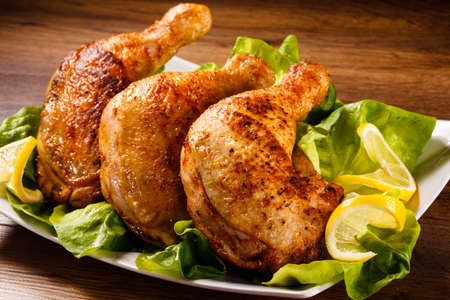 chicken grill: Roast chicken legs and vegetables Stock Photo