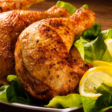 grilled meat: Roast chicken legs and vegetables Stock Photo