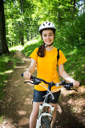 child sport: Healthy lifestyle - teenage girl cycling