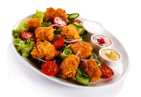 chicken nuggets: Grilled chicken nuggets and vegetables Stock Photo