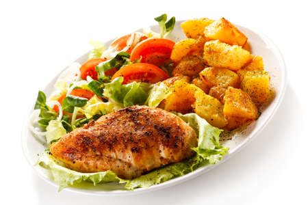 chops: Fried chicken fillet, boiled potatoes and vegetable salad