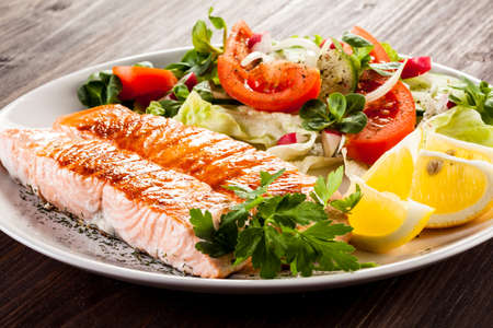 fish plate: Grilled salmon and vegetables Stock Photo