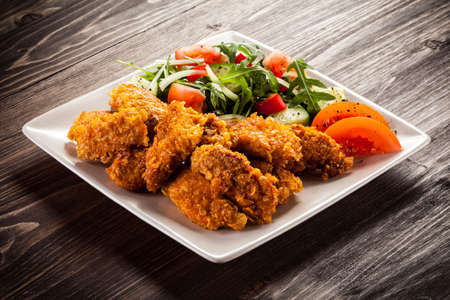 Fried chicken nuggets and vegetables Stock Photo - 49178783