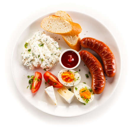 boiled egg: Breakfast - boiled egg, fried sausages, cottage cheese and vegetables
