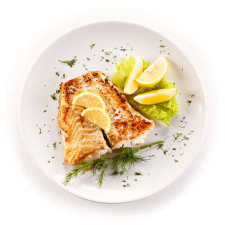 魚料理・揚げ魚の切り身と野菜 写真素材