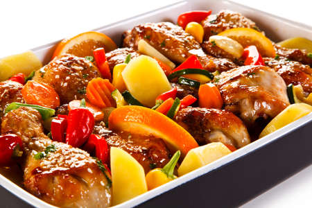 barbecued: Barbecued chicken drumsticks and vegetables
