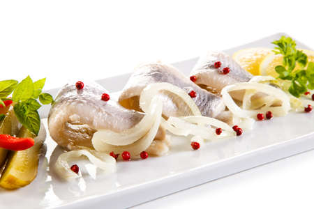 fillets: Marinated herring fillets on a white background Stock Photo