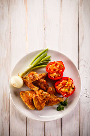 vegetables on white: Grilled chicken wings
