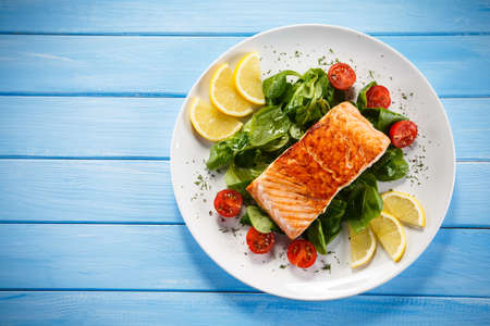 lunch meal: Grilled salmon and vegetables Stock Photo