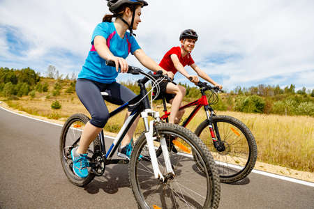road cycling: Healthy lifestyle - teenage girl and boy cycling