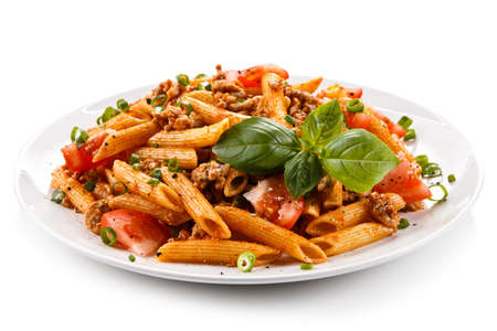 Penne with meat, tomato sauce and vegetables Imagens