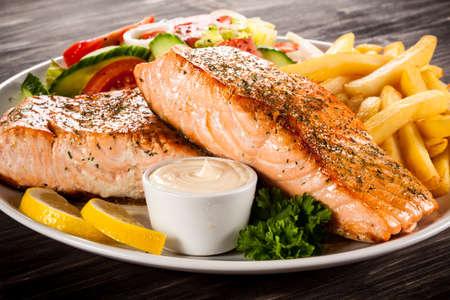 french fried potato: fried salmon Stock Photo