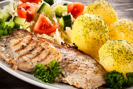 chops: Fried pork chops, boiled potatoes and vegetable salad Stock Photo