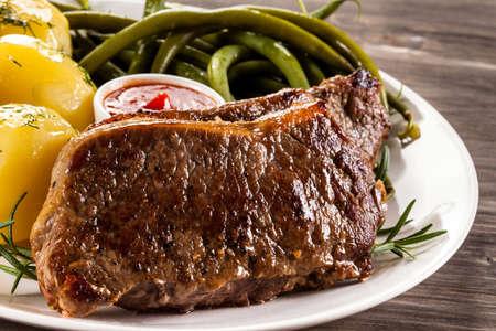 beefsteaks: Beefsteaks, boiled potatoes and vegetables Stock Photo