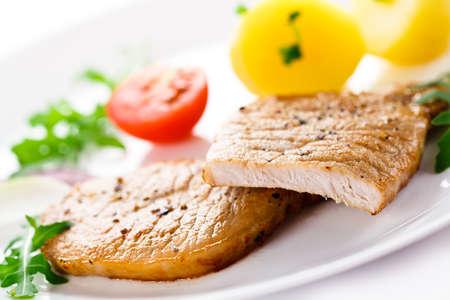 chops: Grilled steaks and vegetable salad