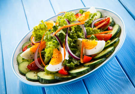 boiled eggs: Boiled eggs and vegetables