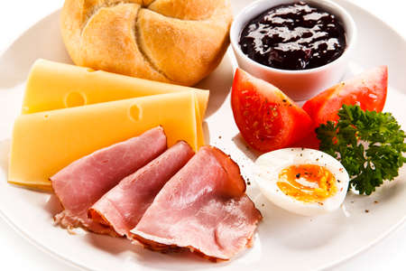 ham: Breakfast - boiled egg, bacon, cheese and vegetables Stock Photo