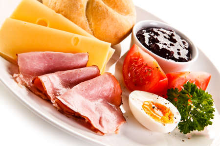 boiled egg: Breakfast - boiled egg, bacon, cheese and vegetables Stock Photo