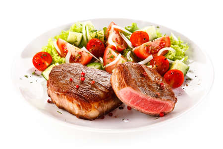 cooked: Grilled steaks and vegetable salad