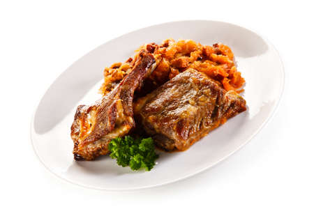 barbecued: Barbecued ribs with vegetables Stock Photo