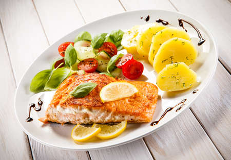 baked: Grilled salmon and vegetables Stock Photo