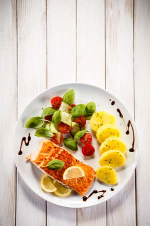 grilled vegetables: Grilled salmon and vegetables Stock Photo