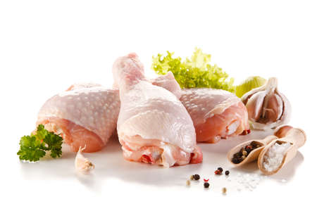 raw: Raw chicken legs on white background