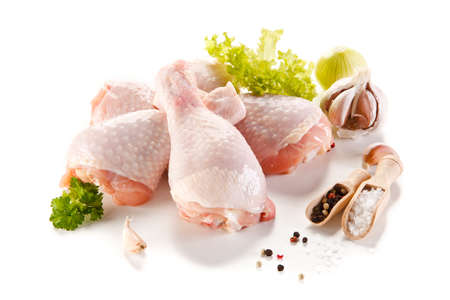 Raw chicken legs on white background