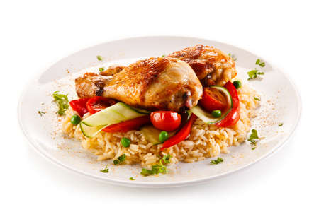 Roasted chicken drumsticks white rice and vegetables