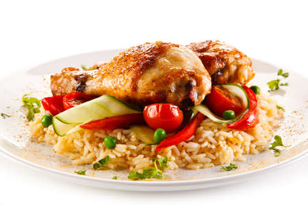 chicken rice: Roasted chicken drumsticks white rice and vegetables