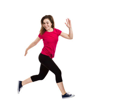 shot: Young woman jumping on white background Stock Photo