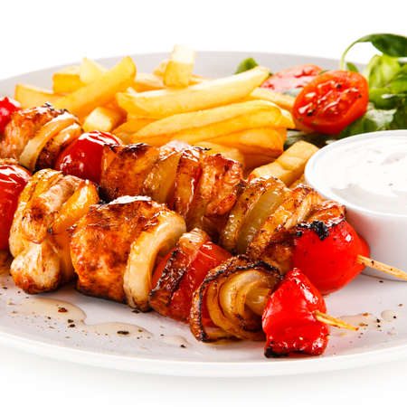 Kebab - grilled meat and vegetables on white background Stock Photo