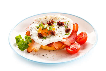 fried: Breakfast - breadroll, fried egg, bacon and vegetables Stock Photo