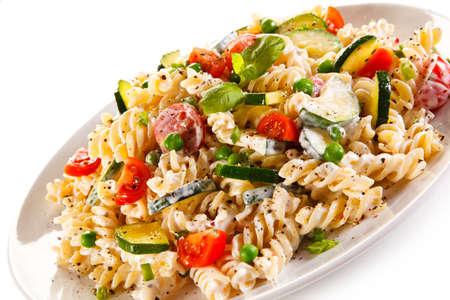 fusilli: Fusilli pasta with white sauce and vegetables Stock Photo