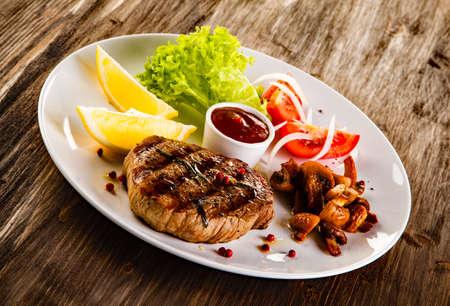 pork chop: Grilled beefsteak and vegetables Stock Photo