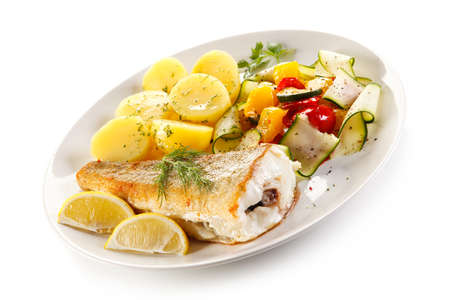fillets: Fish dish - fried fish fillet and vegetables Stock Photo