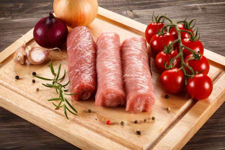 chops: Raw pork chops on cutting board and vegetables