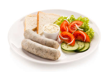 vegetables on white: Breakfast - boiled white sausages, toasts and vegetables Stock Photo