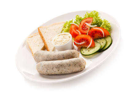 english cucumber: Breakfast - boiled white sausages, toasts and vegetables Stock Photo