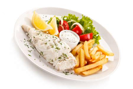 dish fish: Fish dish - boiled fish fillet, baked potatoes and vegetables Foto de archivo