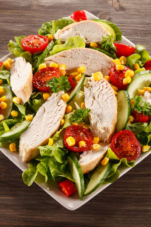 Vegetable salad with grilled chicken and corn