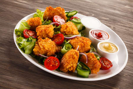 chicken nuggets: Roasted chicken nuggets with salad