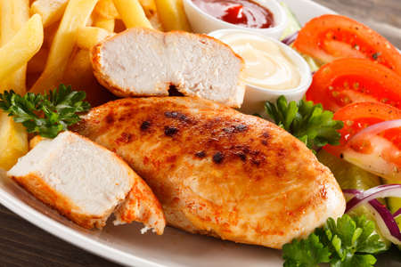 lemon slice: Grilled chicken with french fries Stock Photo