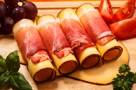 two object: Cheese with smoked ham Stock Photo