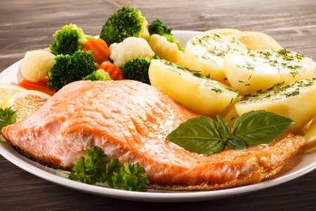 fish plate: Fish dish - roasted salmon Stock Photo