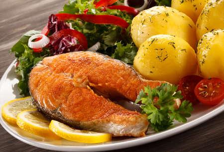 plato de pescado: Fish dish - roasted salmon Foto de archivo