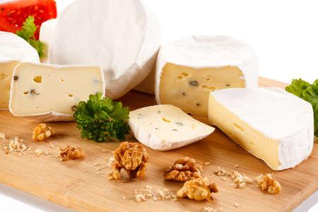 camembert: Camembert cheese on cutting board